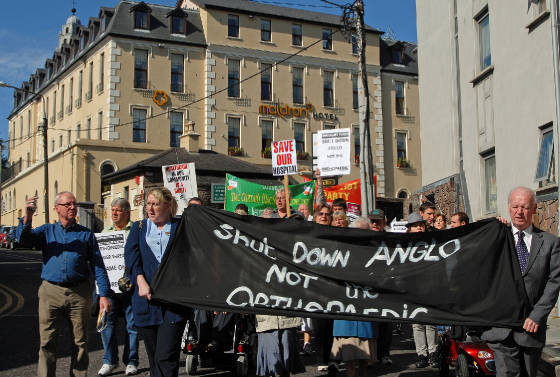 Protest passes the former North Infirmary hospital